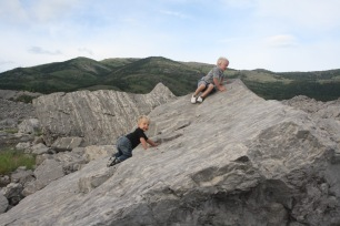 Image result for Pictures of a person rock climbing on a pile of rocks